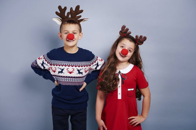 Kids wearing Rudolph noses and antlers
