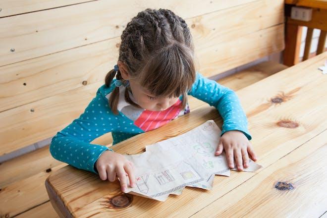 little girl reading treasure hunt map