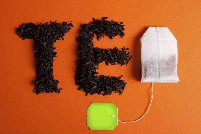 tea bag on orange background