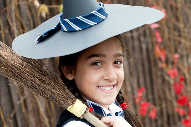 A girl dressed as The Worst Witch