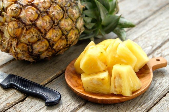 A pineapple and pineapple chunks