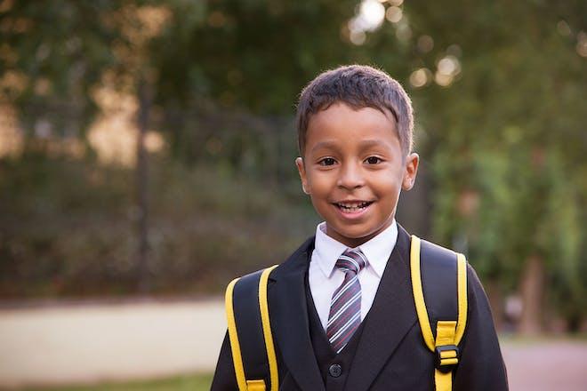 Young boy in school uniform