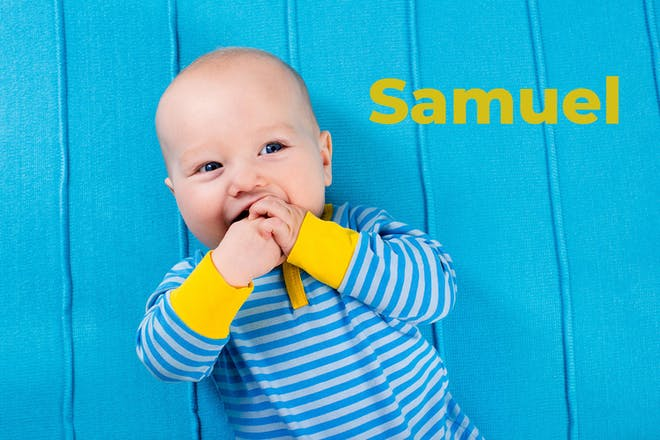 Baby in blue and yellow baby grow. Name Samuel written in text