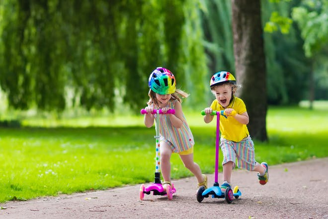 kids on scooters in park