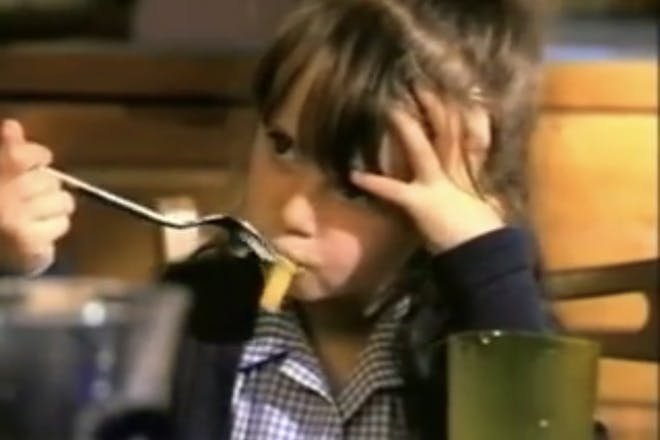 Little girl eats chips from the retro McCain chips advert, Daddy or chips?
