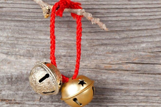 gold bells on red string