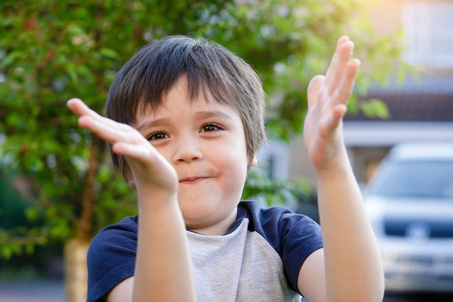 Young boy clapping hands