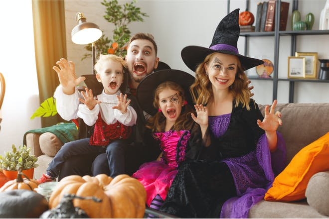 Family of four dressed up in Halloween costumes