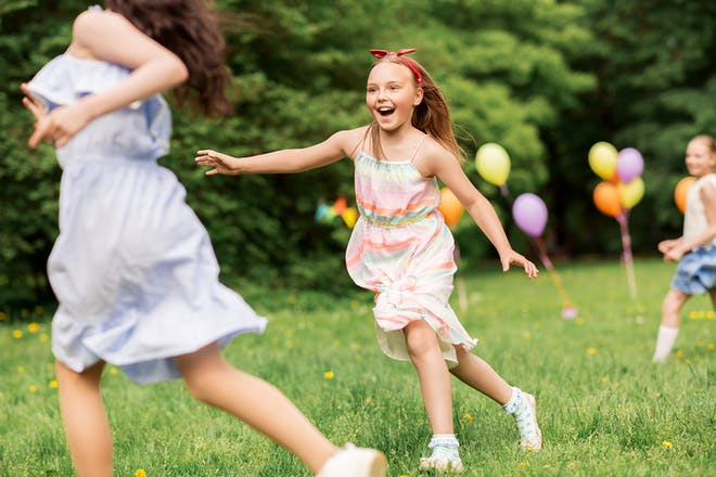 Young girls playing tag