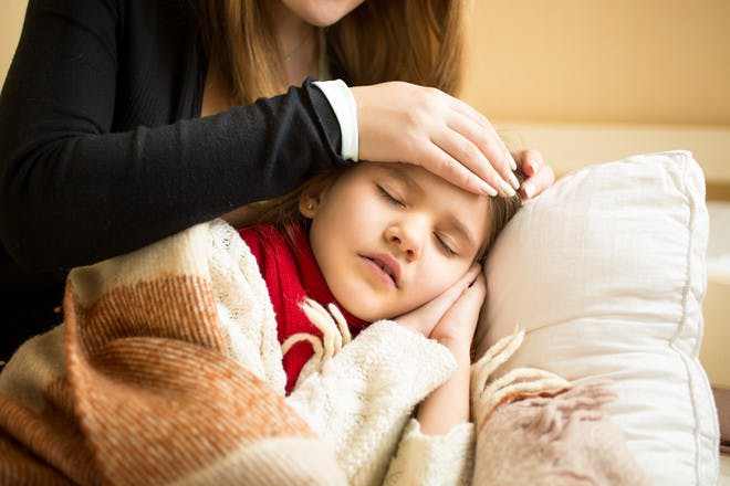 Girl with enterovirus mum feeling forehead