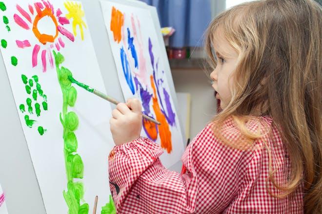 Girl paints in nursery