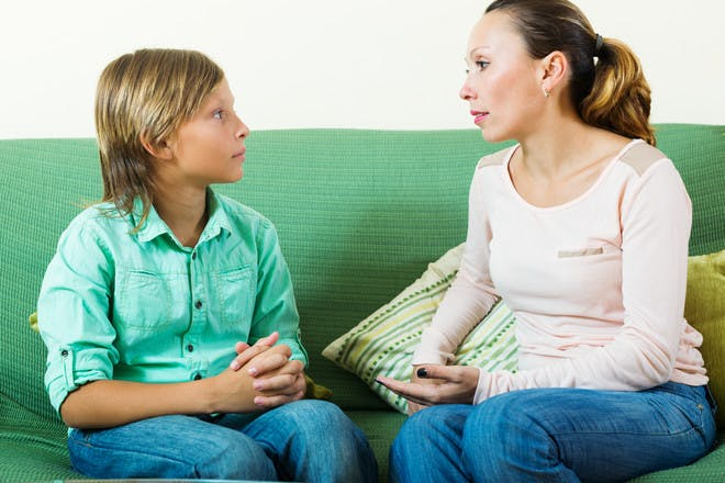 mum and teen son talking