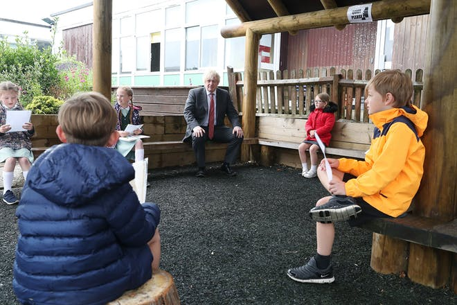 Boris sitting socially distanced with primary school pupils
