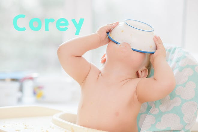 Baby in high chair tipping bowl of food into mouth. Text says Corey
