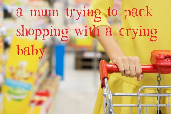 woman pushing trolley in supermarket