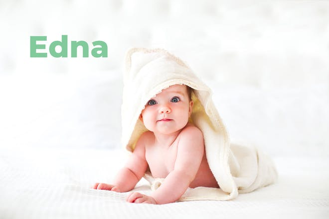 Baby wearing hooded towel. Name Edna written in text