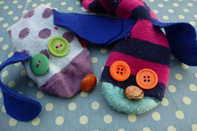 sock puppets made from one striped and one spotty sock with buttons for eyes and nose