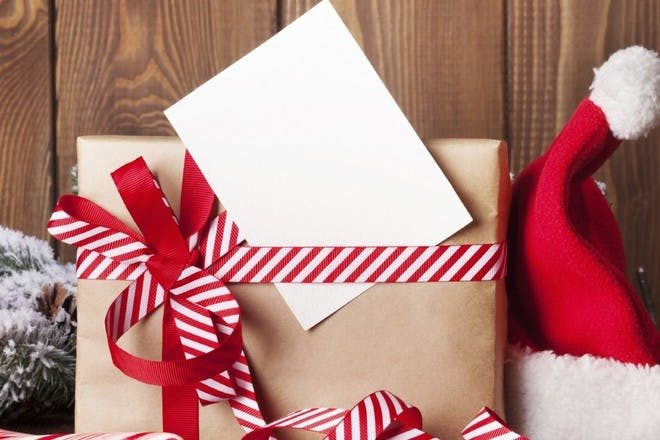 gift wrapped in brown paper and red and white ribbon