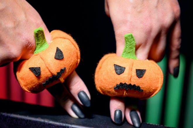 Two pumpkin finger puppets made from felt