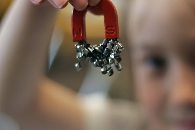 girl holding magnets