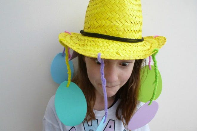 straw hat with egg decorations