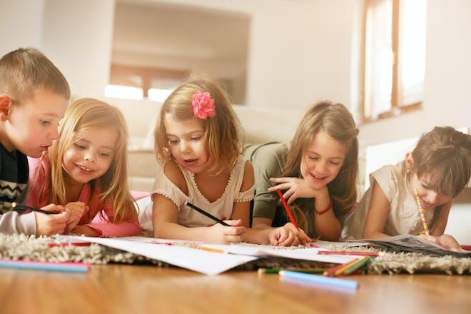 Group of children colouring in at home