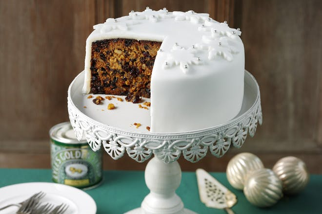Traditional Christmas cake recipe with marzipan, white fondant icing and snowflake decorations