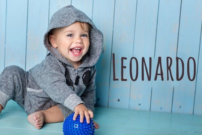 baby with hoodie holding ball