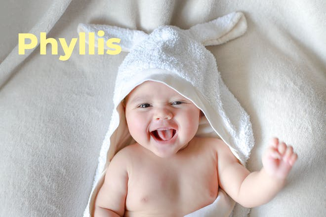 Baby with hooded towel with rabbit ears. Name Phyllis written in text