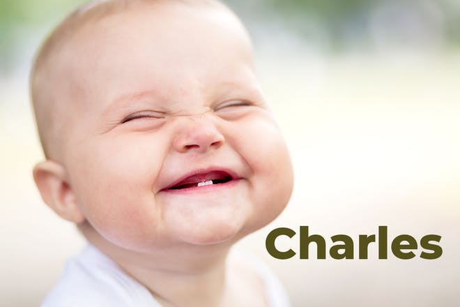 Grinning baby next to name Charles written in text