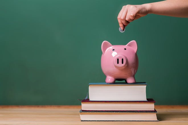 Piggy bank on pile of books
