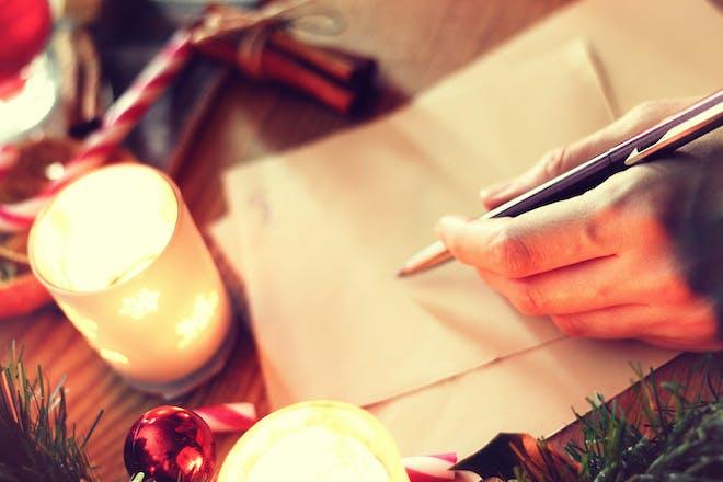 Someone writing something at Christmas