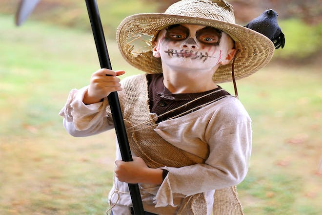 Little boy dressed as a scarecrow