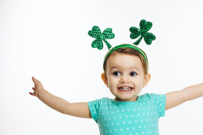 Little girl with Irish four leaf clover headband