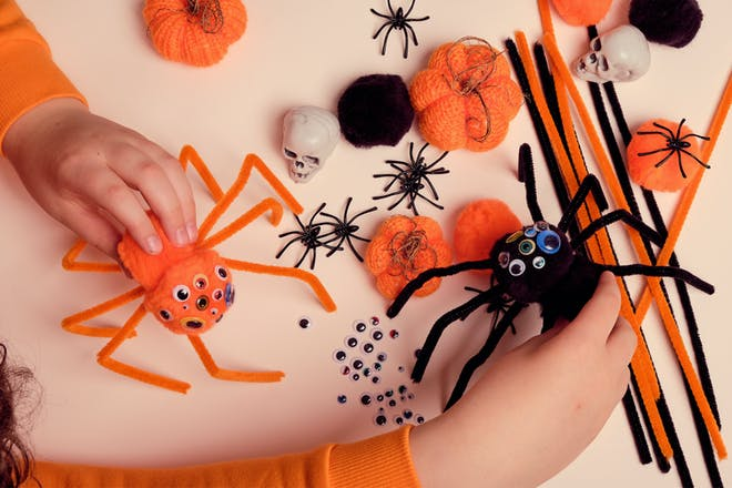 Orange and black pom pom spider craft for Halloween