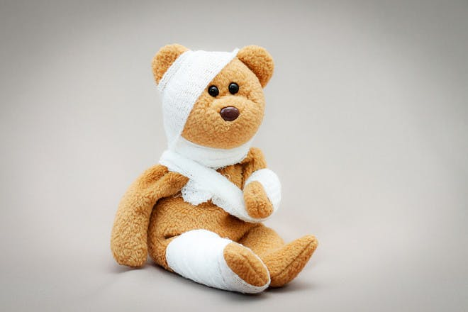 bear wrapped in bandages