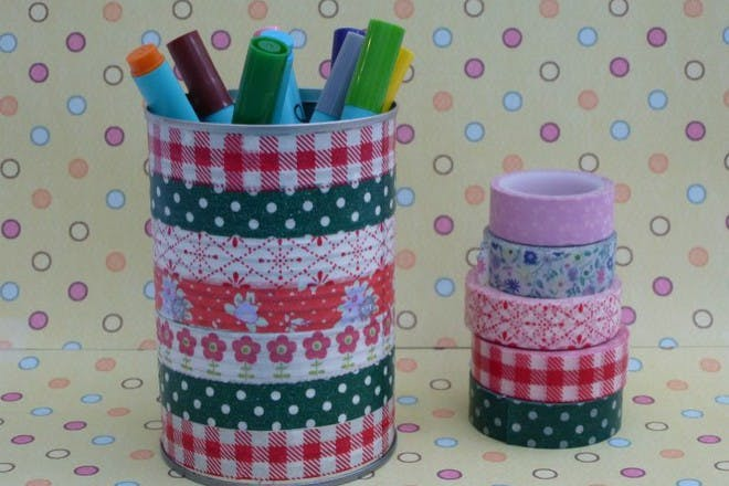 colourful storage pot with sharpies inside on patterned background