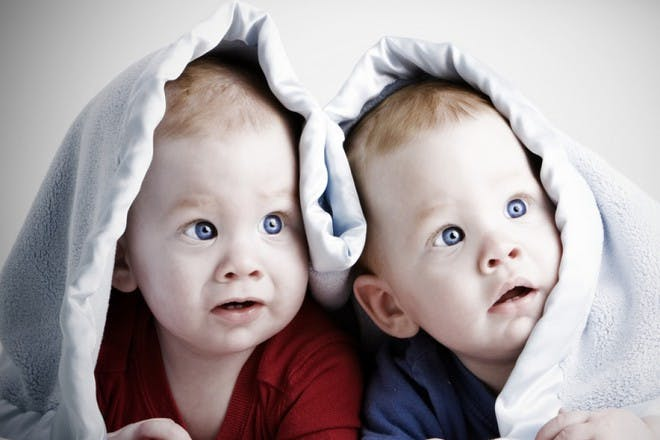 two babies under blanket
