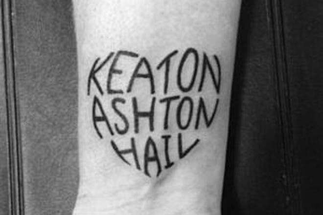 Names in a heart tattoo