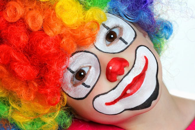 Halloween face paint for a clown