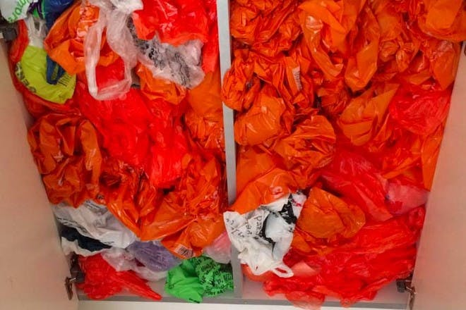 17. And a cupboard filled with plastic bags