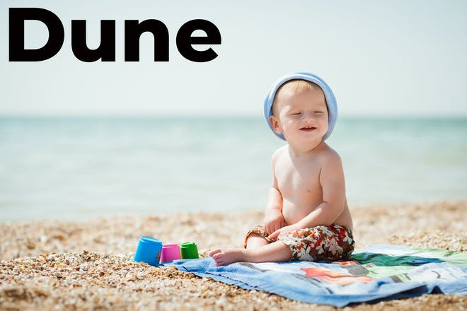Boy on the beach with the word Dune in text