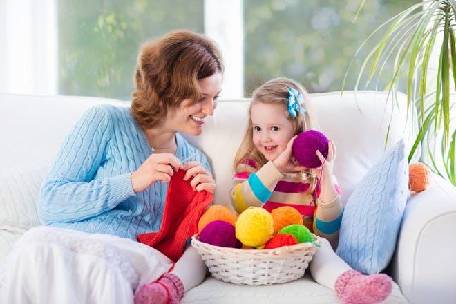Mum knitting with daughter