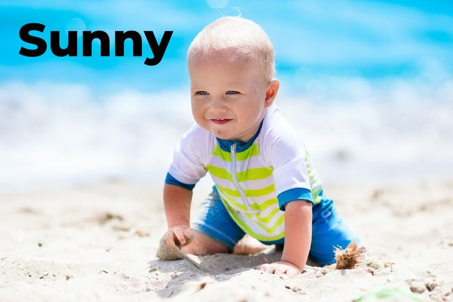 Baby on the beach with the words Sunny in text
