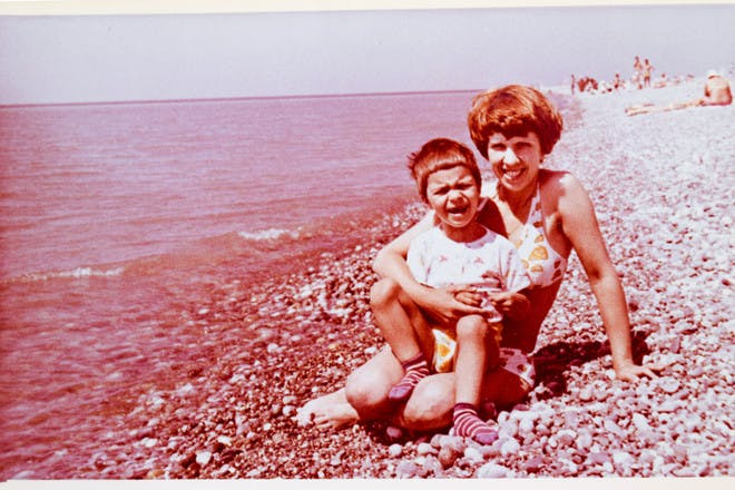 Vintage photo, mum and child on beach