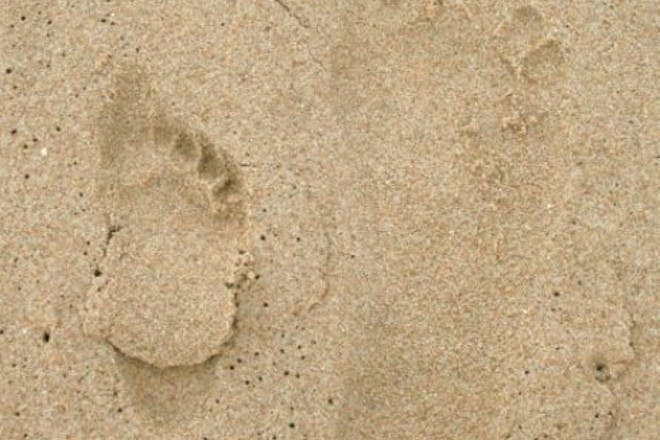 big and small footprints in sand