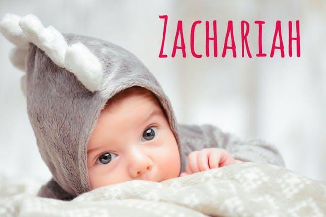 baby in hooded onesie