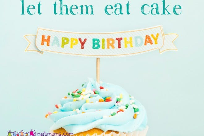 cupcake with blue icing and happy birthday sign