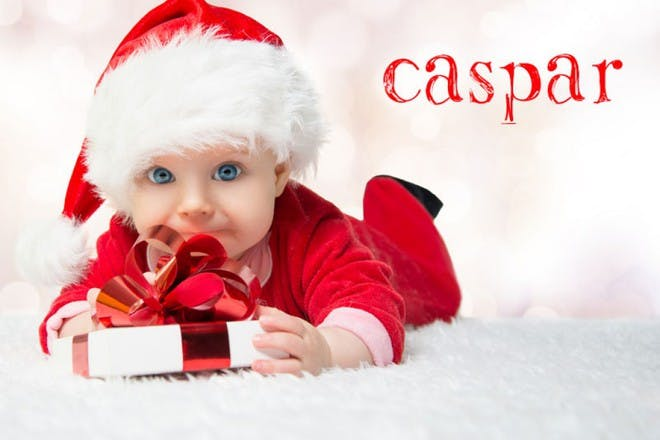 baby in christmas hat holding gift