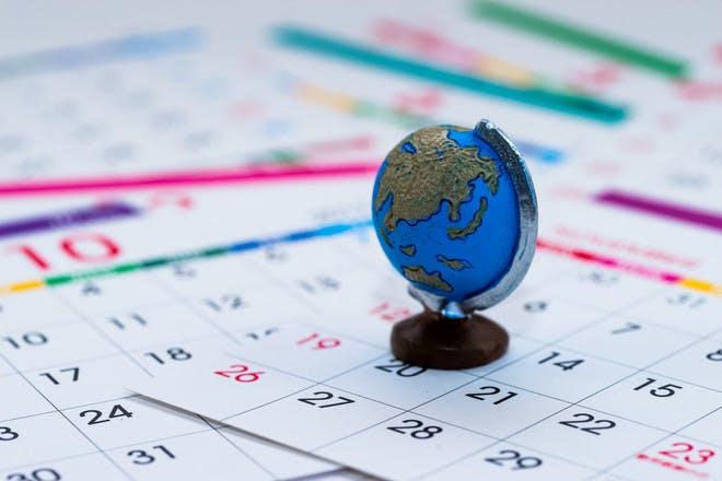 Globe sitting on a calendar